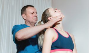 The woman gets chiropractic treatment for her jaw dislocation.